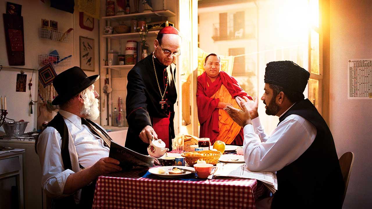 Religionsvertreter an einem Tisch | (c) IRAS COTIS