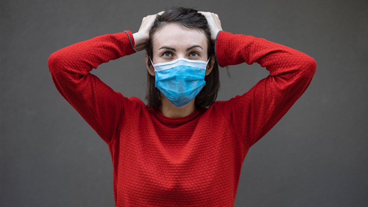 Frau mit Hygienemaske. | (c) unsplash