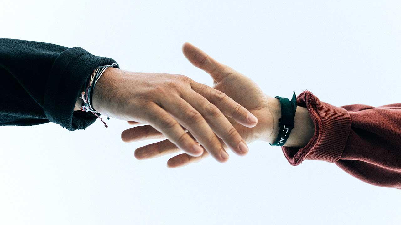 Händeschütteln: Zusammenarbeit
