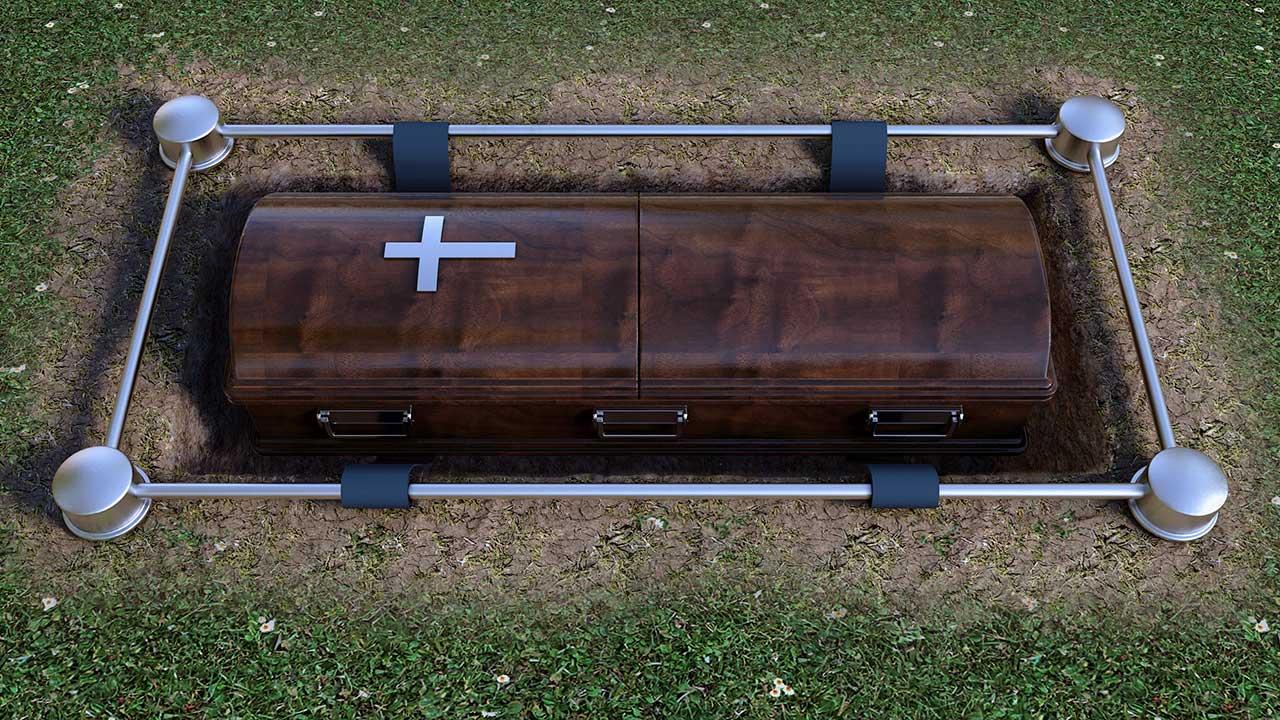 Sarg in einer Friedhofswiese