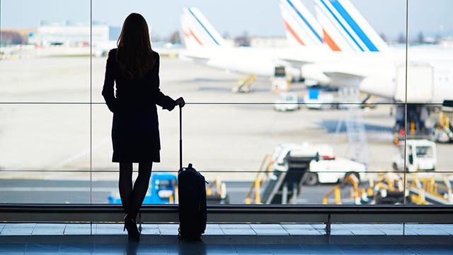 Geschäftsfrau auf Reisen